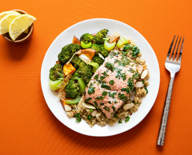 salmon on a plate with veggies and quinoa