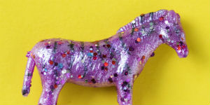 purple horse covered in sparkles
