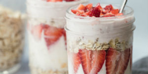 granola, yogurt and berries in a mason jar