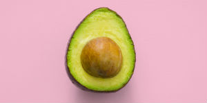 avocado on a pink background