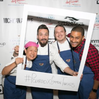 Chef Anita Lo, Chef Fabio Viviani, Chef Brad Kilgore, and Chef JJ Johnson with the #PolaroidxCommonThreads Polaroid frame at the opening event in Chicago