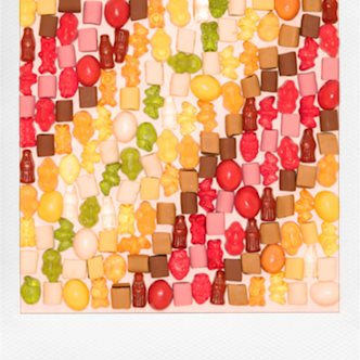 Polaroid photo of candy arranged into colored diagonal bands, made by Gudrun Wronski
