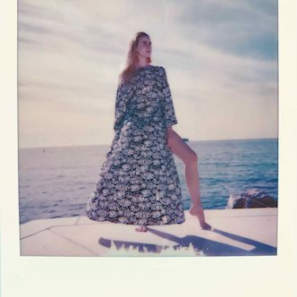 Polaroid photo of a female model posing in front of the Croatian sea