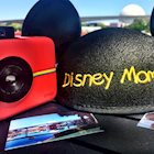 "Polaroid Snap with Polaroid pictures next to Disney-branded, black, mouse-eared hat labeled ""Disney Mom"""