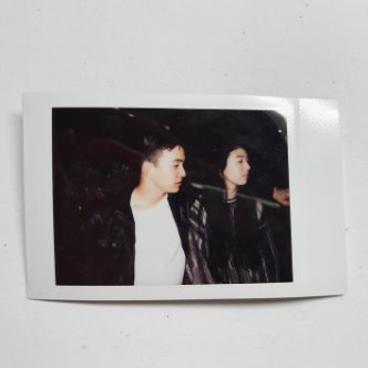 Polaroid photo of Piper Curda and her brother