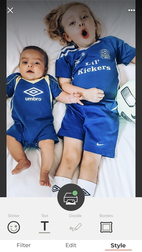 Two boys in blue soccer jerseys