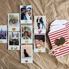 Polaroid photos with emojis on them next to red and white striped envelopes with red hearts