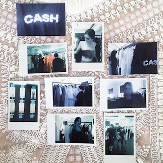 Polaroid pictures of New York Fashion Week 2017 laid out on a white, embroidered comforter