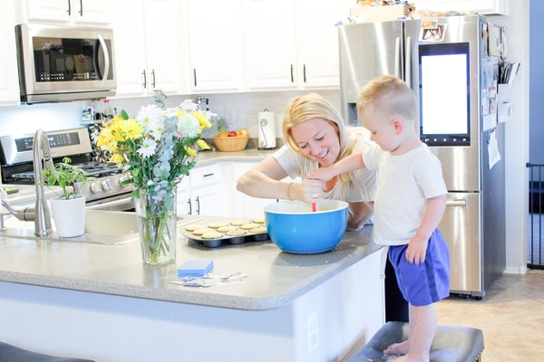 Photo of Jessica Dowd mixing muffin mix with her son