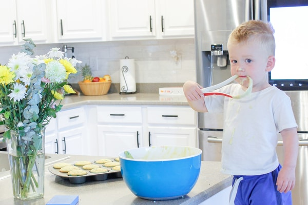 Photo of Jessica Dowd's son eating muffin mix off the whisk
