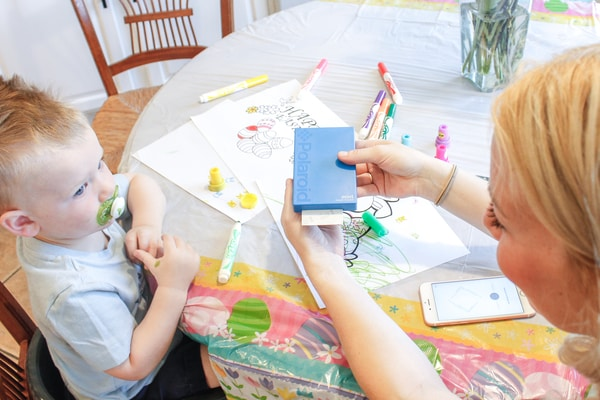 Photo of Jessica Dowd printing picture of her son with the Polaroid Mint Instant Digital Pocket Printer