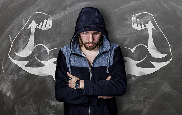 man in hood with buff around drawn behind him.
