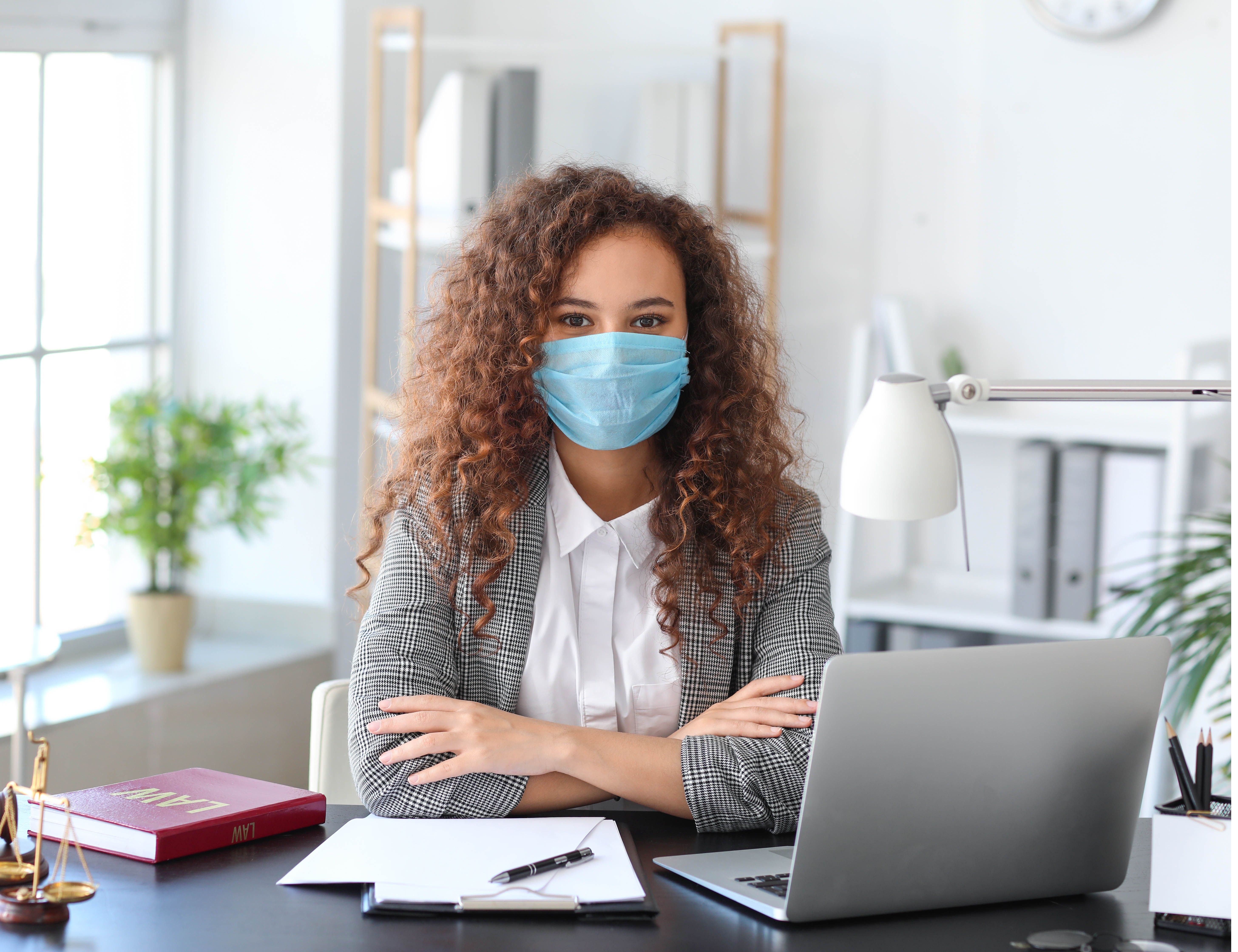 Woman Wearing a Mask Working in the Office