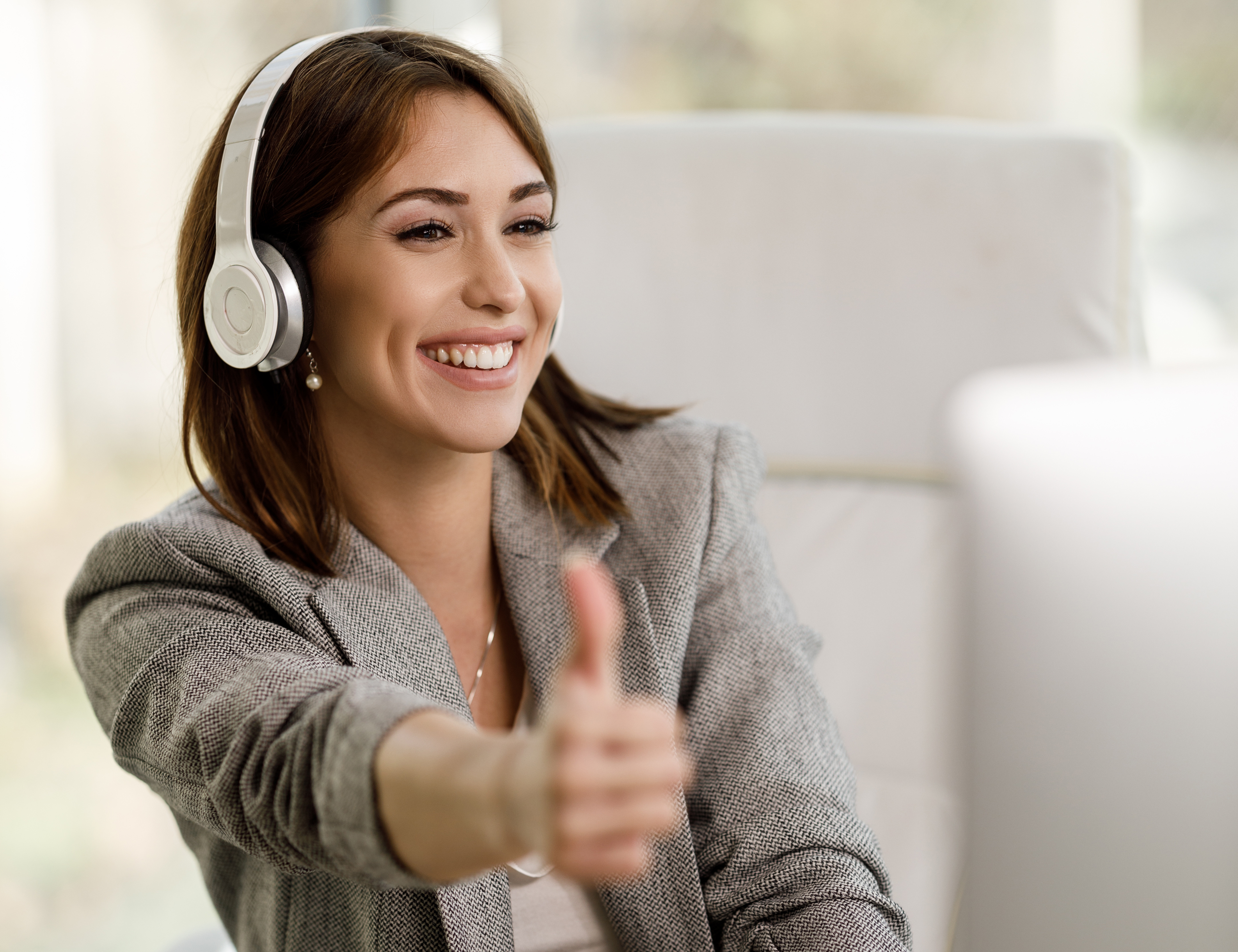 Women Remote Worker Smiling and Giving Thumbs Up