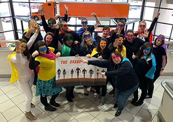Members of Schneider's Marketing Team dress as brand protectors for Halloween.