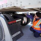 Schneider Driver Instructor Dana performs a CDL pre-trip inspection.