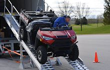 Schneider Dedicated driver delivering UTV off trailer