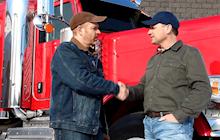 Truckers shaking hands